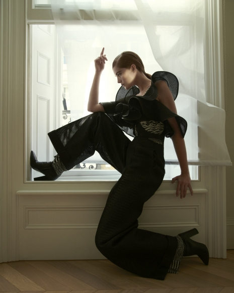Fashion Photographer Andreas Ortner NYC Numéro Alexina Graham Pose in the Window